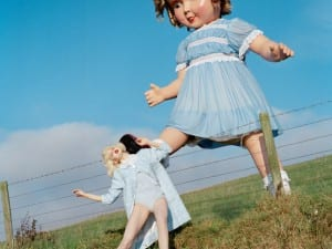 Tim Walker, Giant Doll Kicks Lindsey Wixson, 2011. Eglingham Hall, Northumberland.