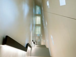 Titan Extension Historical Museum, Bern, :MLZD. A dramatic staircase cascades within the south façade and gives access to all five storeys.